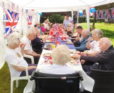 Residents enjoy a garden party